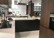 Wood-finished-furniture-for-a-modern-corner-kitchen-GamaDecor-217x155