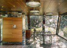 Wood-glass-and-metal-give-the-interior-a-classy-contemporary-look-217x155