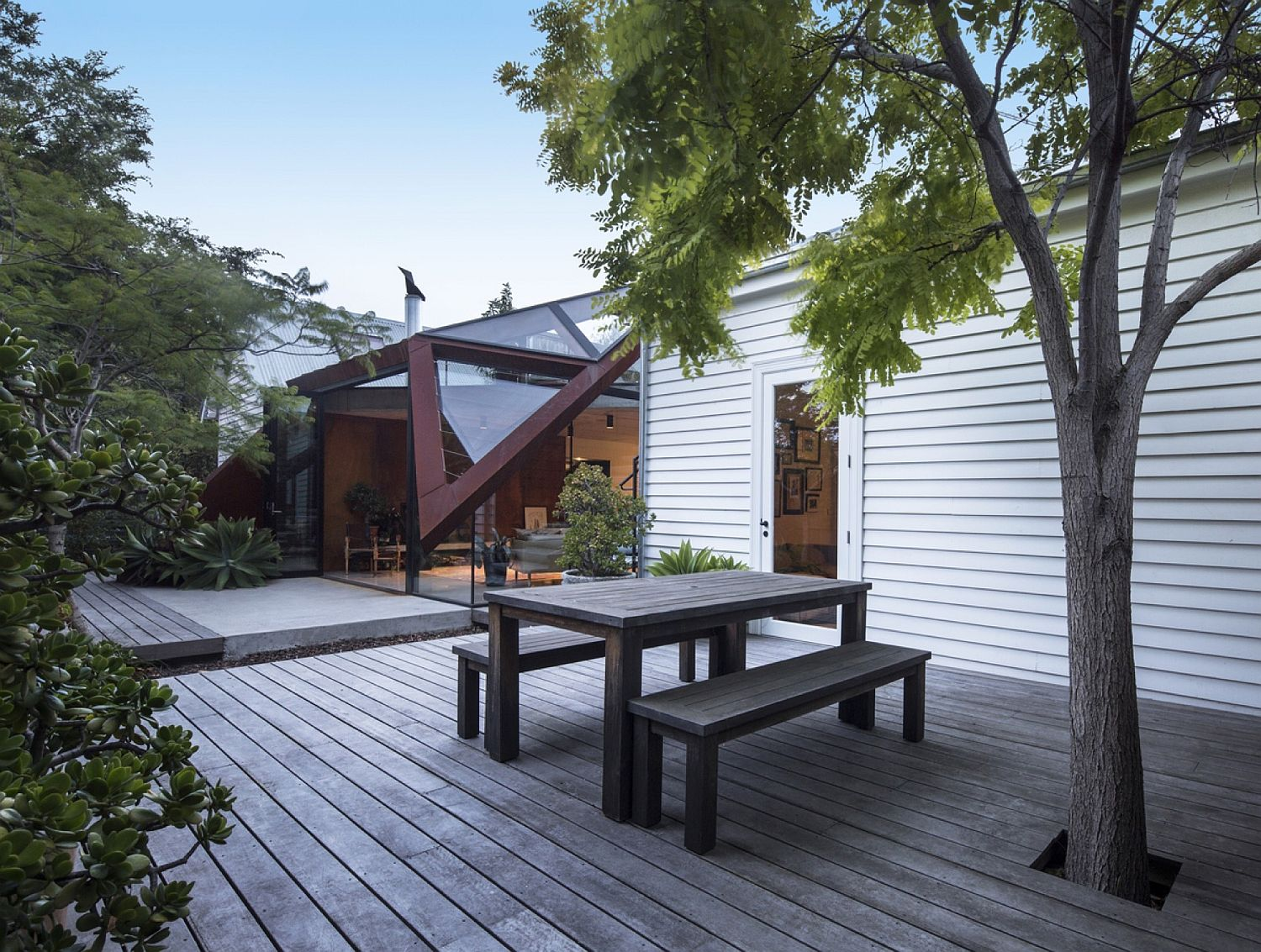 Wooden-deck-of-the-Melbourne-home-filled-with-greenery
