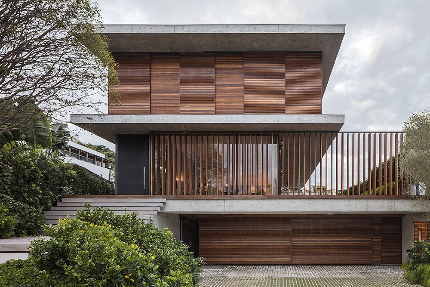 Bravos House Encased In Moving Wooden Panels And Slats