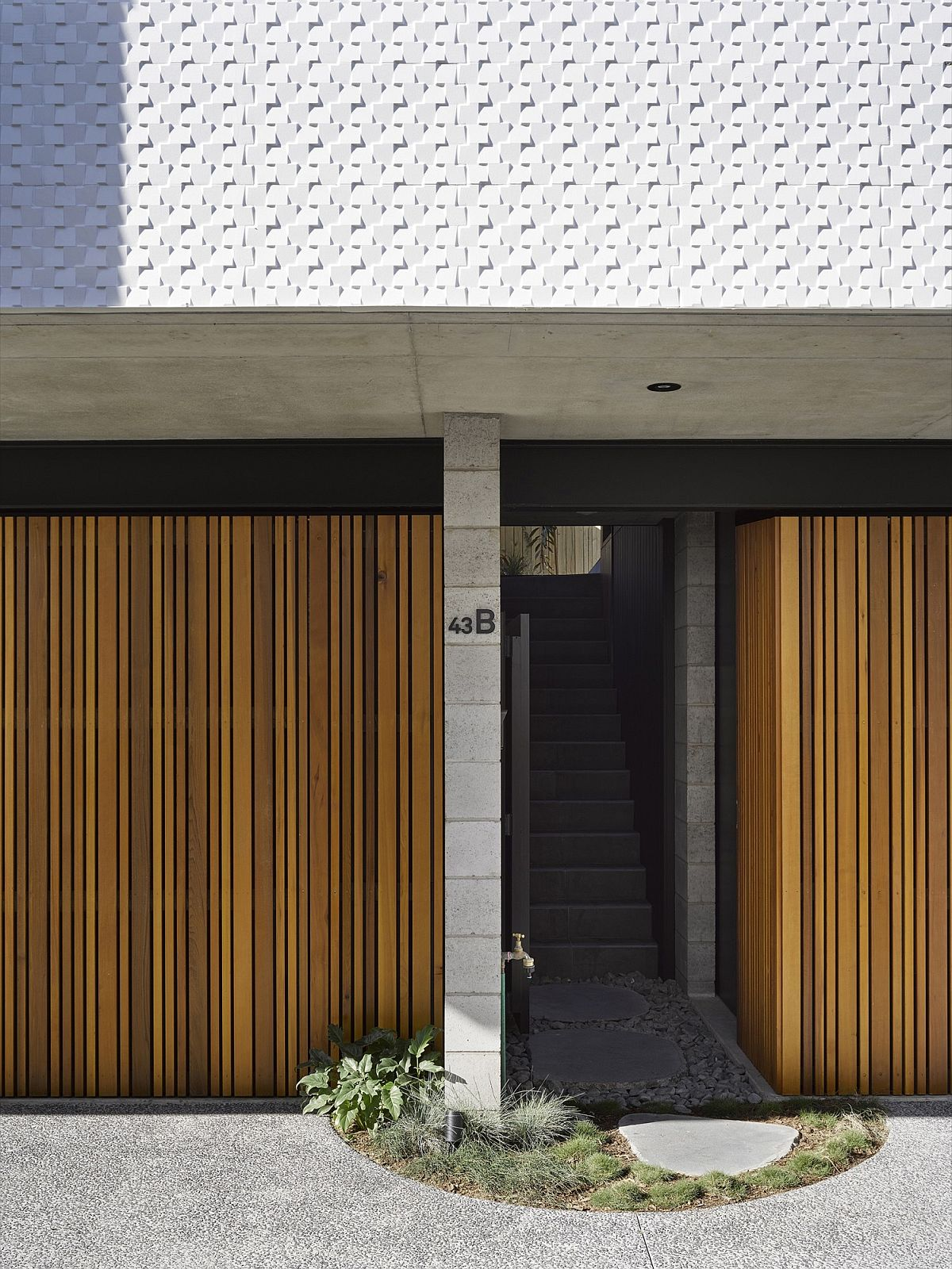 Wooden slats create a stylish and cool entry