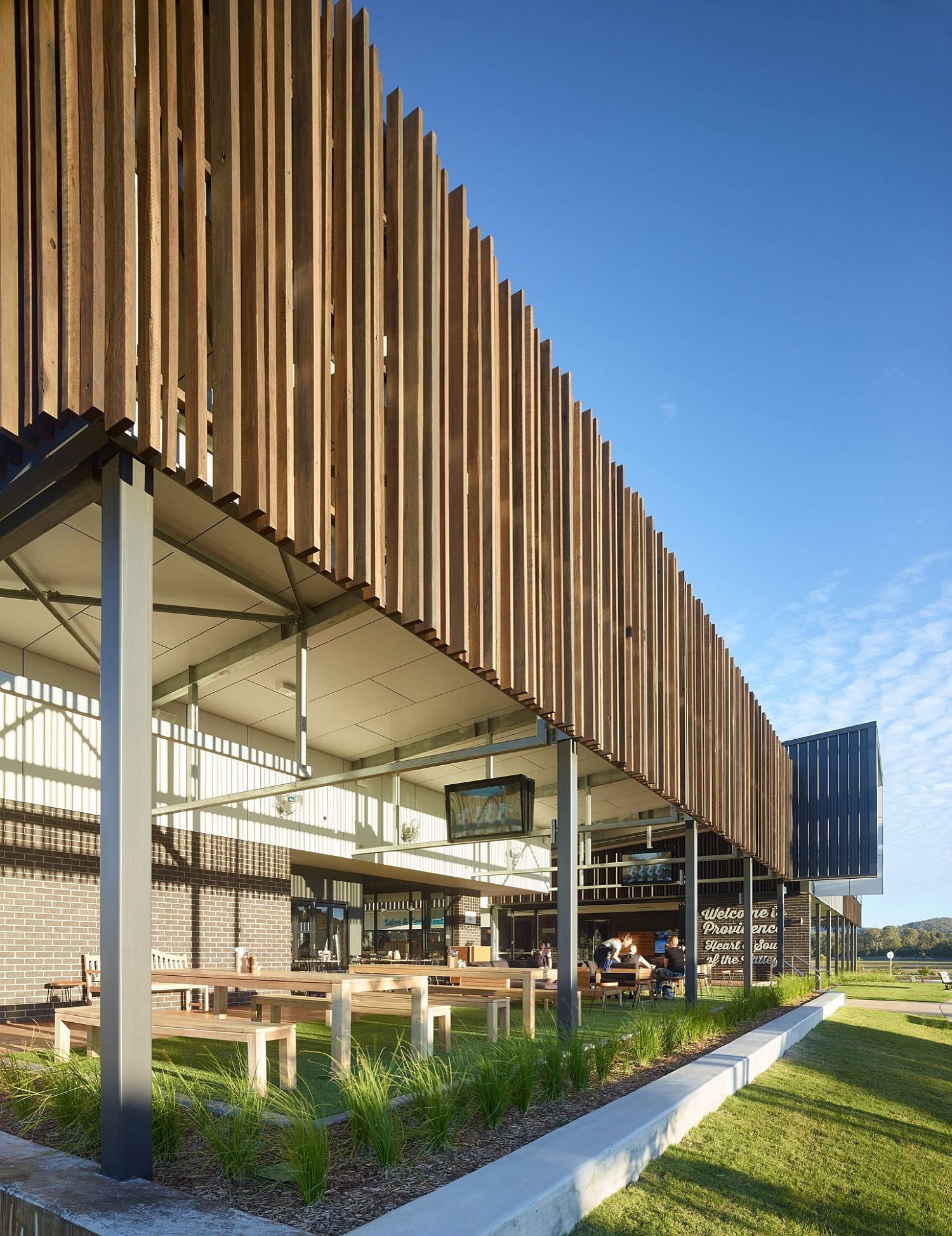 Wooden slats give the facade of the building a unique look