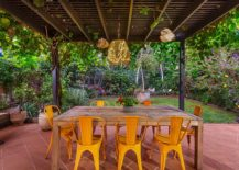 Wooden-table-and-bright-yellow-chairs-for-alfresco-dining-on-the-terrace-217x155