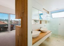 Wooden-wall-separates-the-bedroom-from-the-master-bath-in-style-217x155