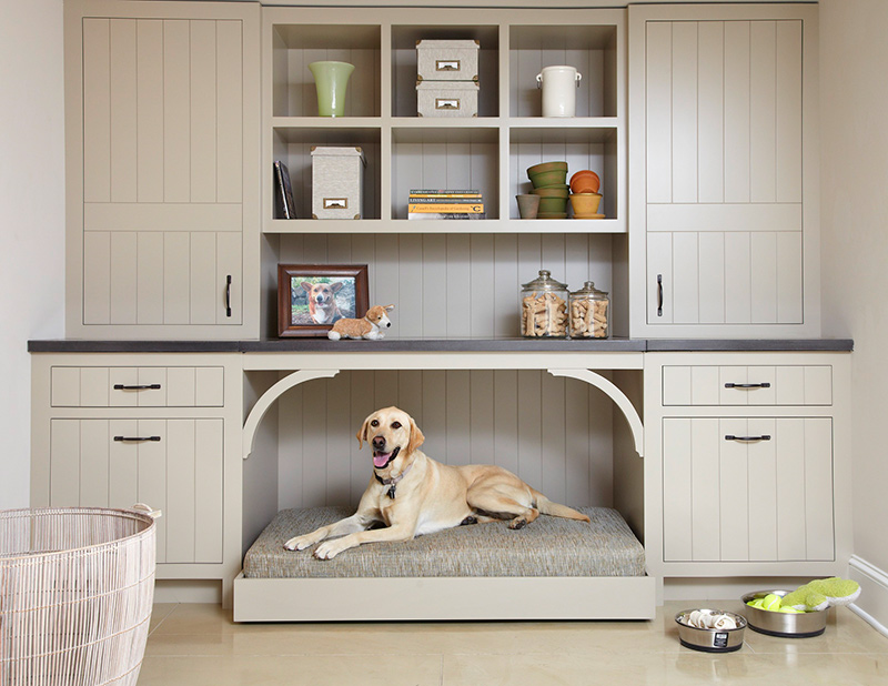 A big storage cabinet with a built-in dog bed