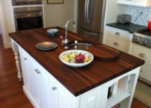 A-high-class-wooden-countertop-with-a-dark-charm-217x155