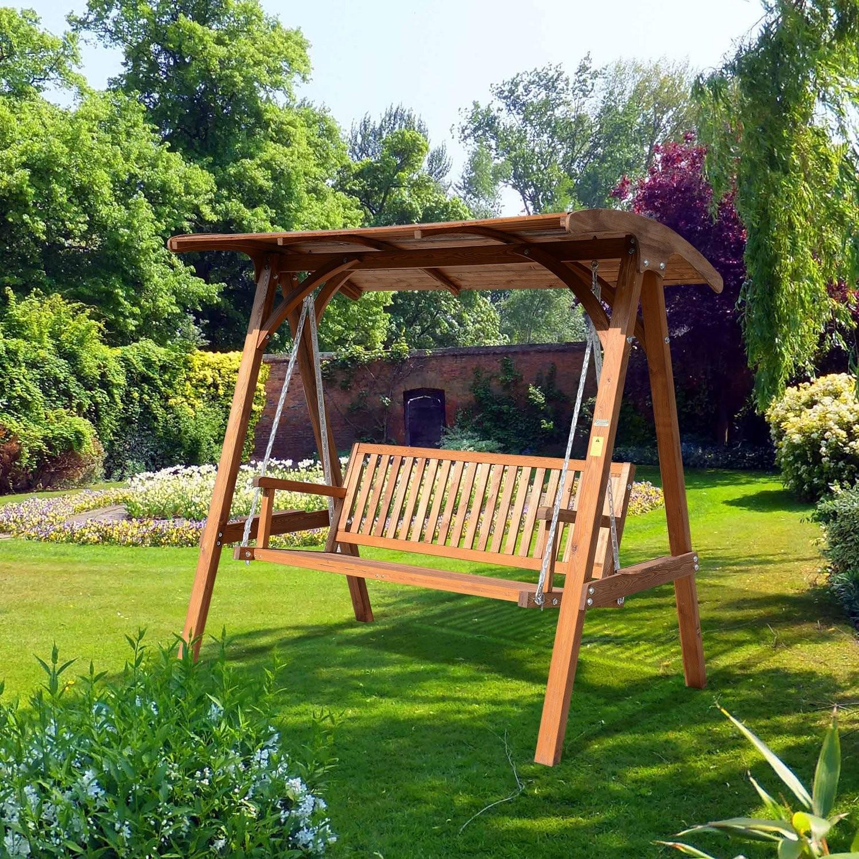 A plain wooden garden swing as the centerpiece