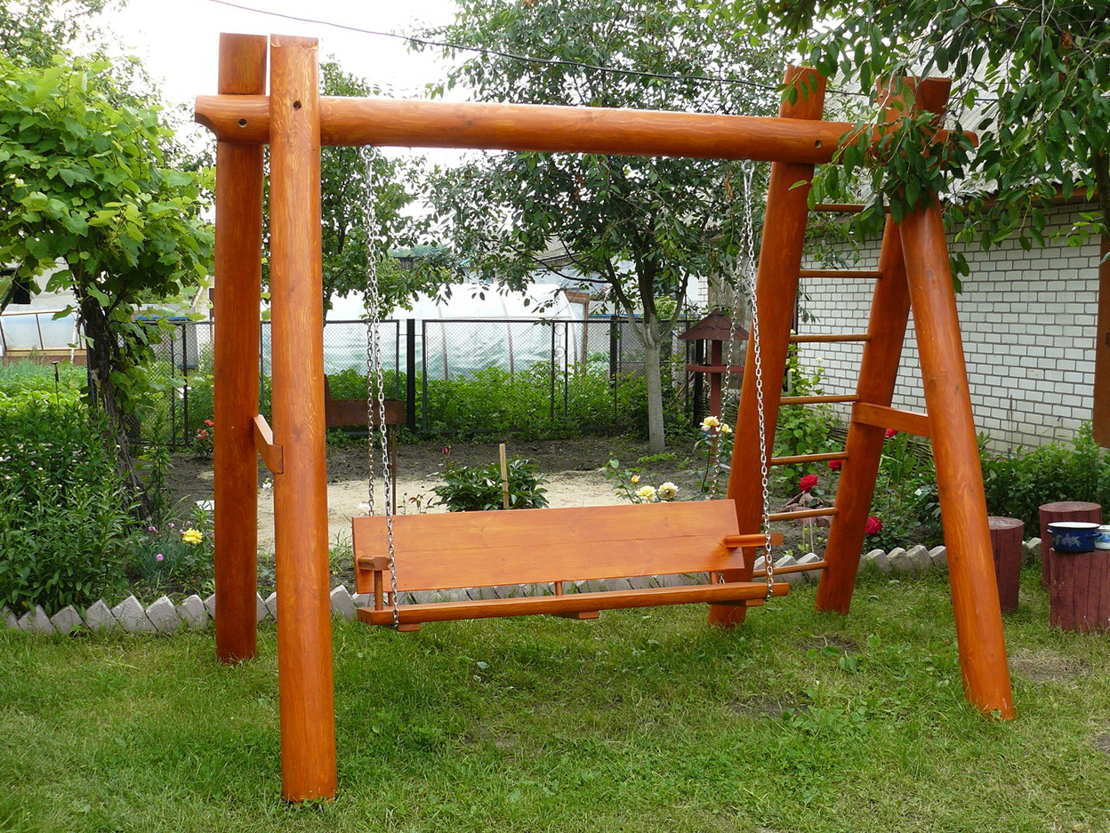 Garden swings the enchanting element in your backyard for White porch swing with stand