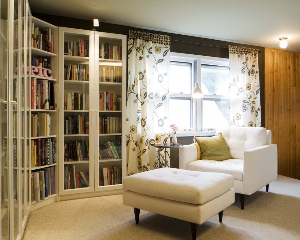 A spacious nook with a big reading chair and ottoman