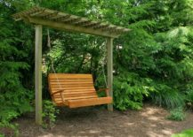 A-wooden-swing-inside-a-bushy-garden-217x155