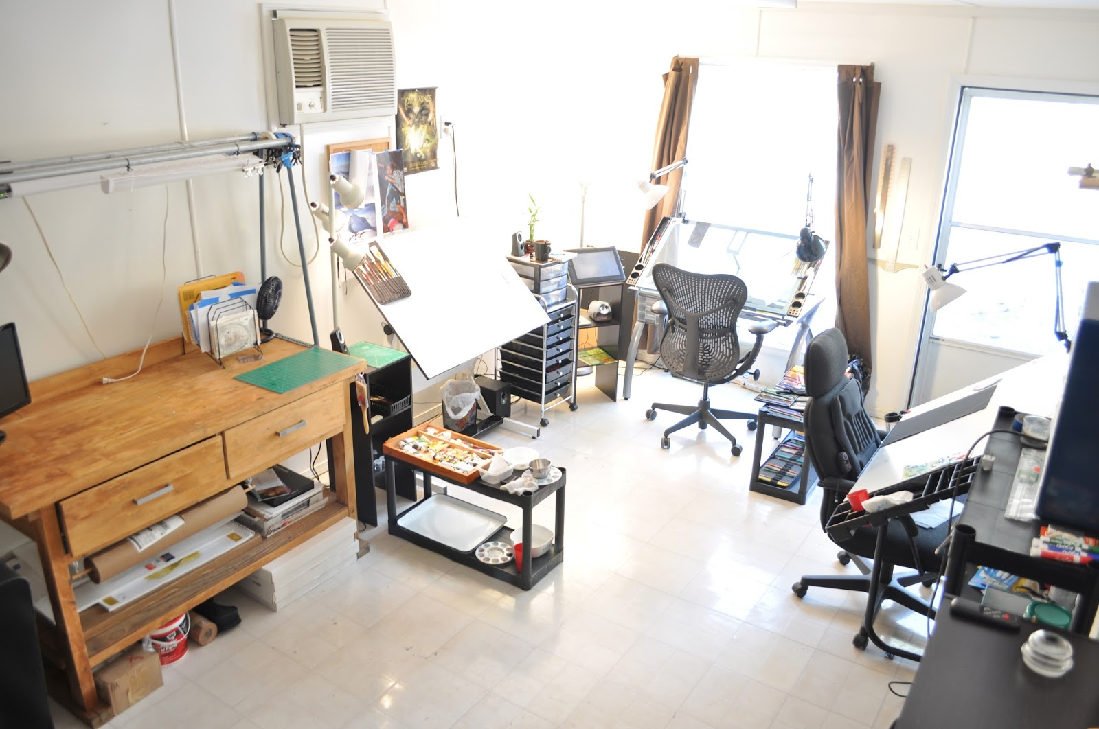 home art studio with multiple artist areas