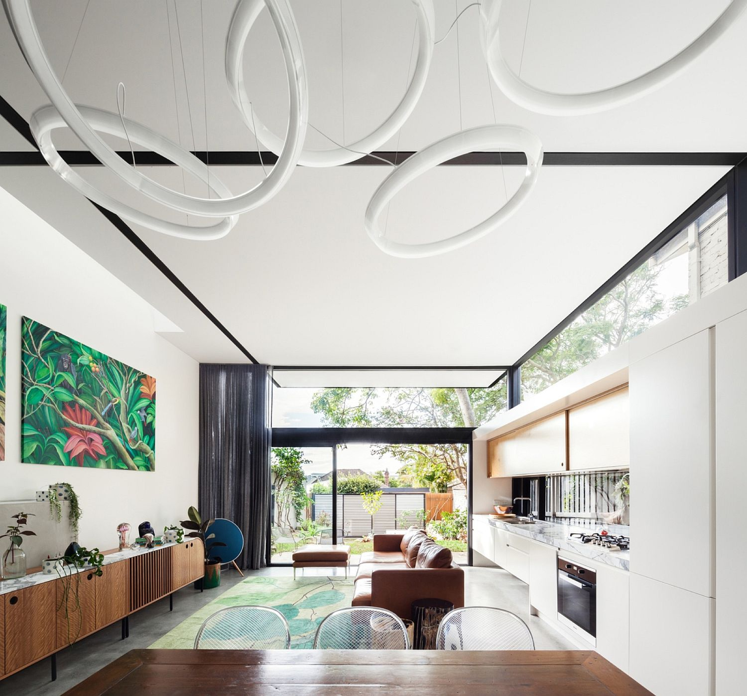 Art work brings color to open living area in white