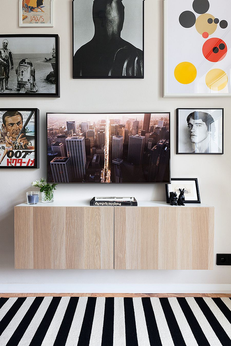 Artwork combined with framed posters and fun prints to create a cool gallery wall