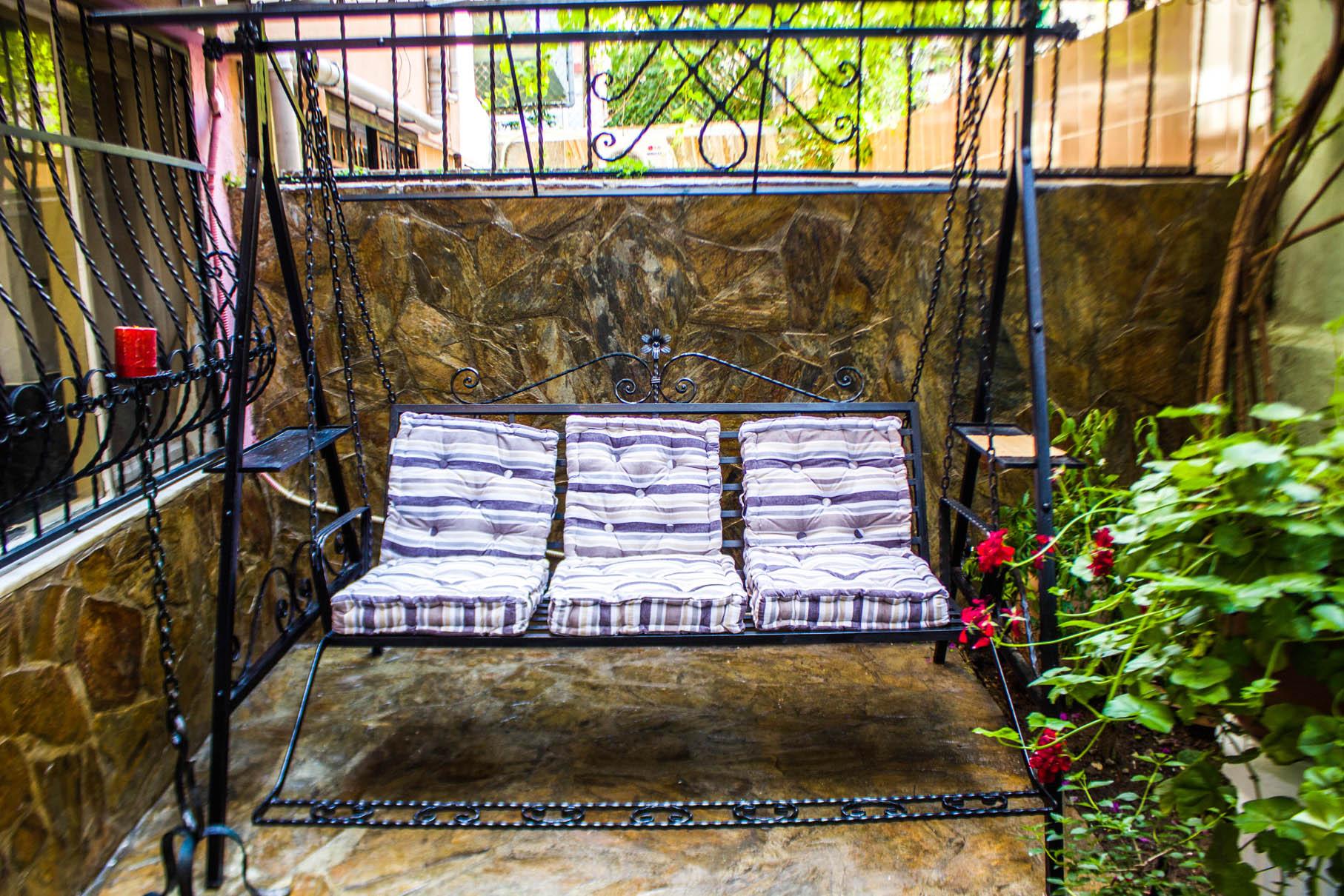 Balcony garden swing with an industrial look
