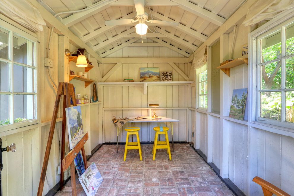 Barn studio with two yellow stools