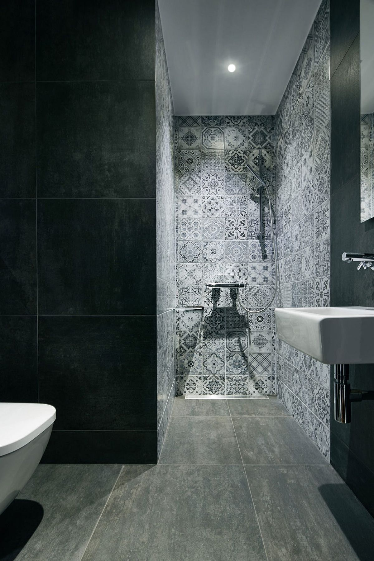 Bathroom in gray with patterened tiles