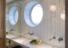 Bathroom-with-a-round-window-right-above-the-sink--217x155