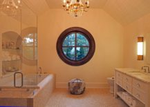 Bathroom-with-a-round-window-that-contrasts-the-interior-217x155