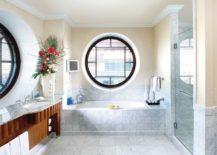 Bathroom-with-soft-beige-walls-and-big-round-windows--217x155