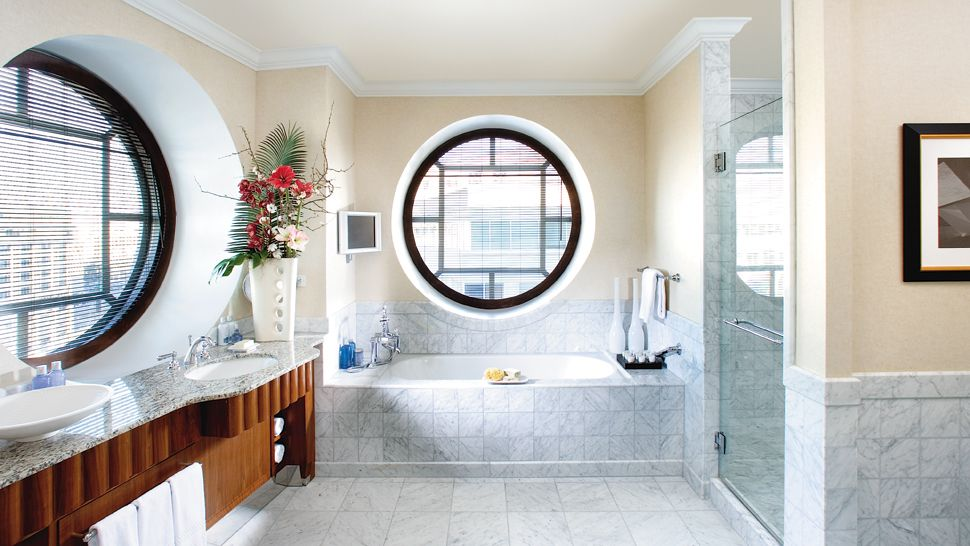 Bathroom with soft beige walls and big round windows