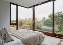 Bedroom-in-white-with-large-sliding-glass-doors-217x155