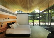 Bedroom-is-connected-with-the-landscape-using-glass-walls-217x155
