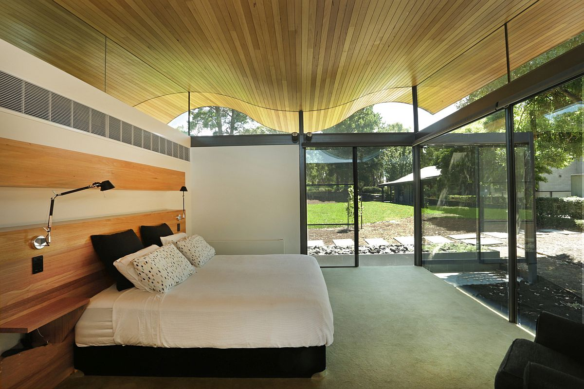 Bedroom is connected with the landscape using glass walls