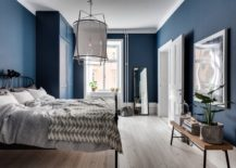 Blue-bedroom-with-an-interior-that-feels-curious-and-enigmatic-217x155