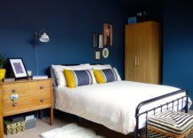 Blue-bedroom-with-colorful-decor-pieces--217x155