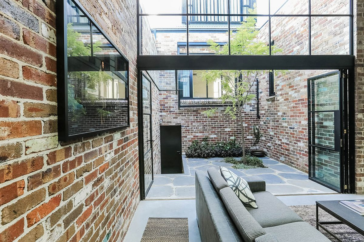 Brick, steel and concrete preserve the industrial appeal of the garage home