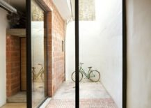 Brick-wood-and-glass-come-together-inside-the-remodeled-cycle-shop-217x155