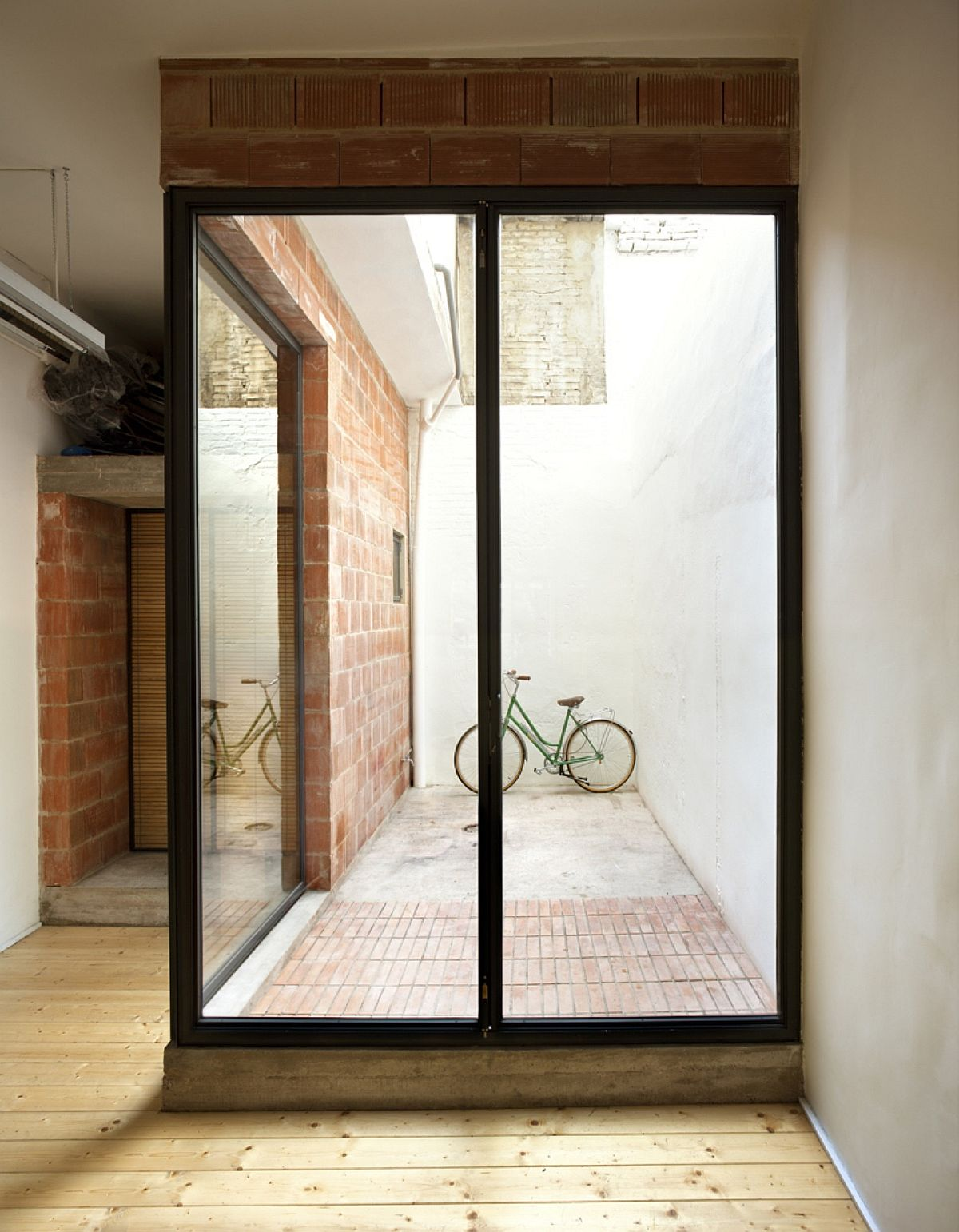 Brick-wood-and-glass-come-together-inside-the-remodeled-cycle-shop