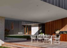 Cantilevered-structure-of-the-home-offers-shade-for-the-outdoor-dining-and-barbecue-zone-217x155