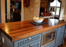 Charming-polished-wooden-countertop-for-a-stylish-kitchen-217x155
