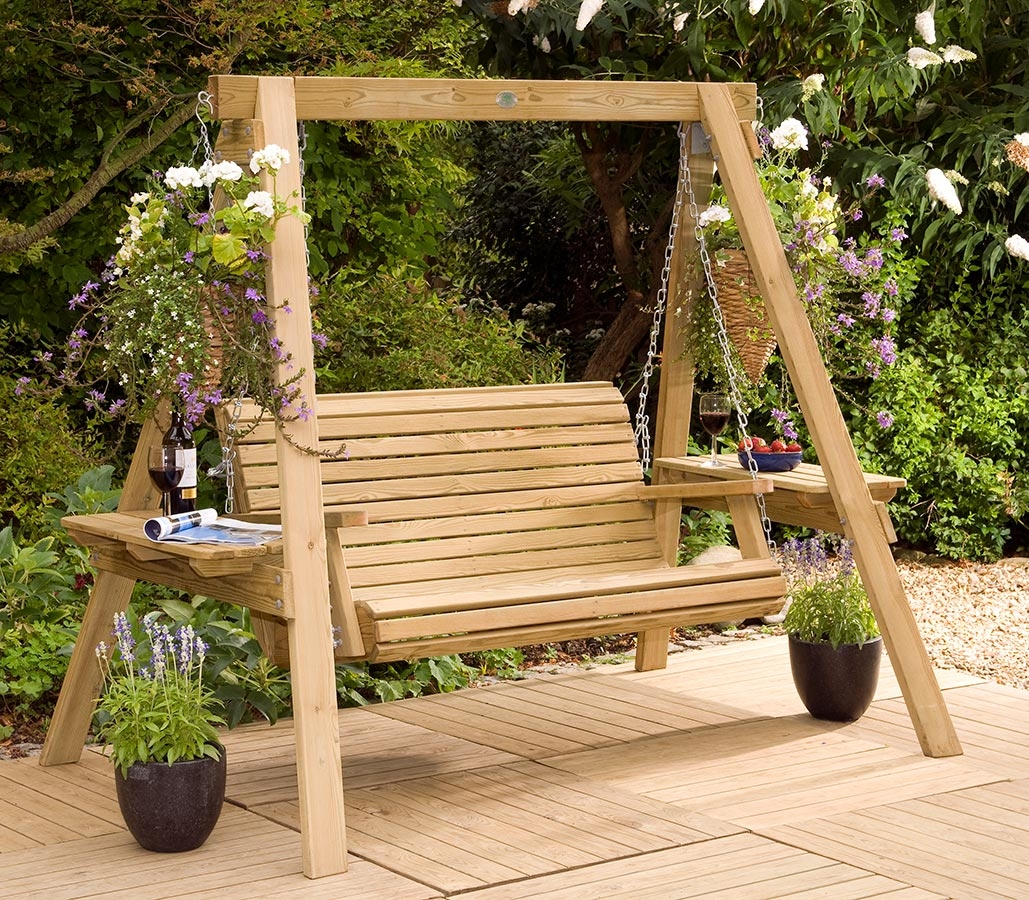Garden swings the enchanting element in your backyard for Building a wooden swing
