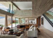 Concrete gives the interior a relaxing modern appeal 217x155 Expansive Living: Multiple Volumes Create a Breezy Brazilian Home
