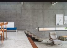 Concrete-wall-in-the-backdrop-creates-a-neutral-setting-with-texture-217x155