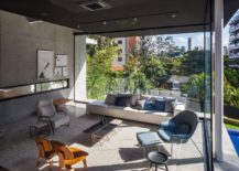 Concrete-walls-and-dark-ceiling-of-the-Brazilian-home-217x155