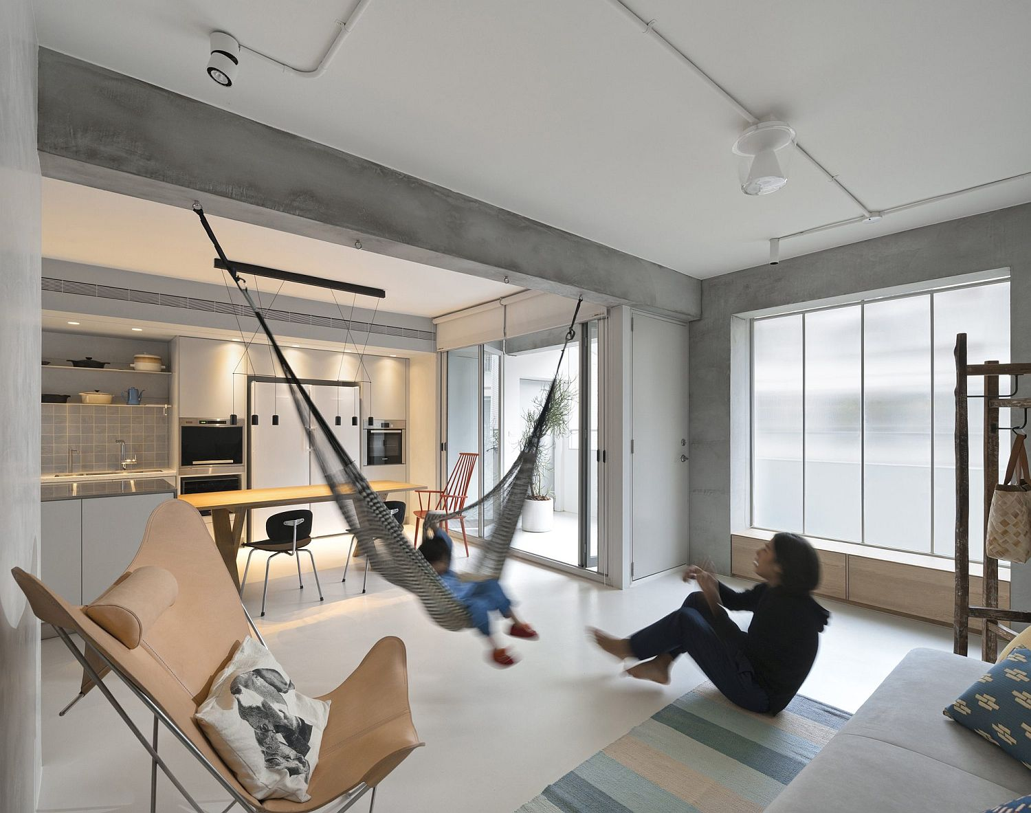Contemporary apartment in Taipei with a hammock in the living room This Space Savvy Taipei Apartment Does Away with Unnecessary Walls
