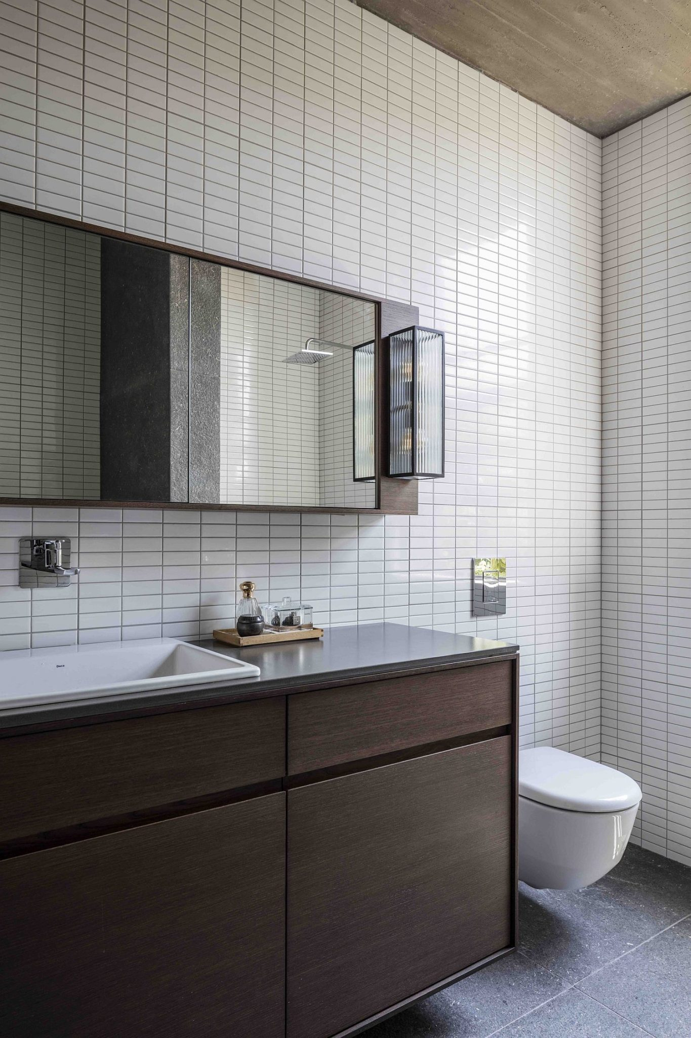 Contemporary bathroom with white tiles and a wooden vanity