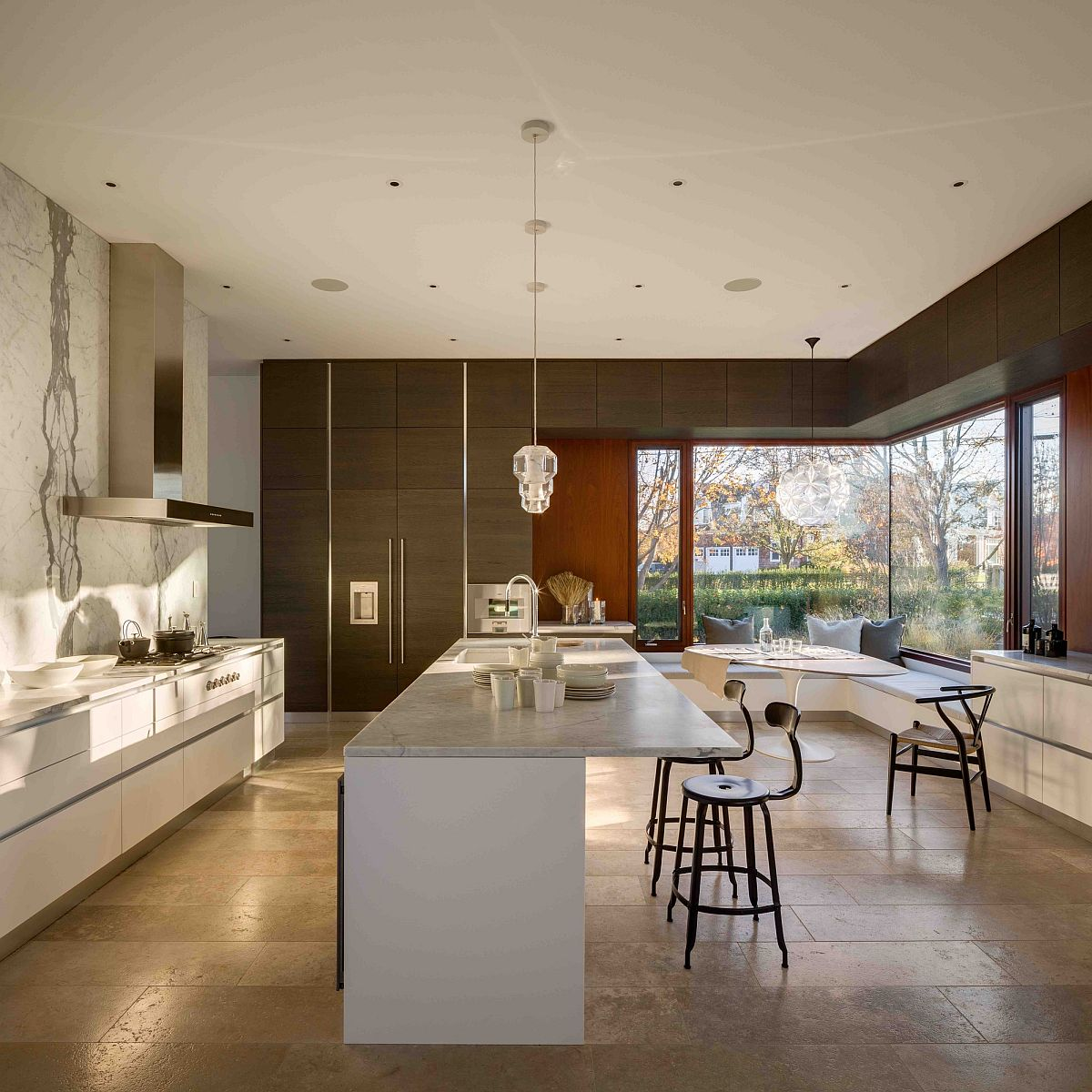 Corner window in the kitchen with seating gives a glimpse of the outdoors