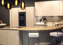 Creative-kitchen-design-from-Pedini-with-smart-curved-breakfast-bar-217x155