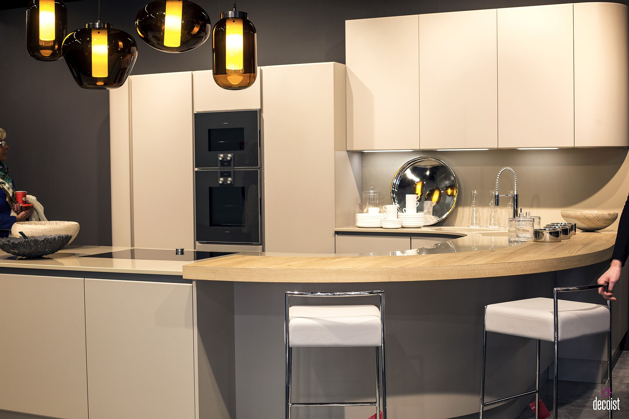 Creative kitchen design from Pedini with smart, curved breakfast bar