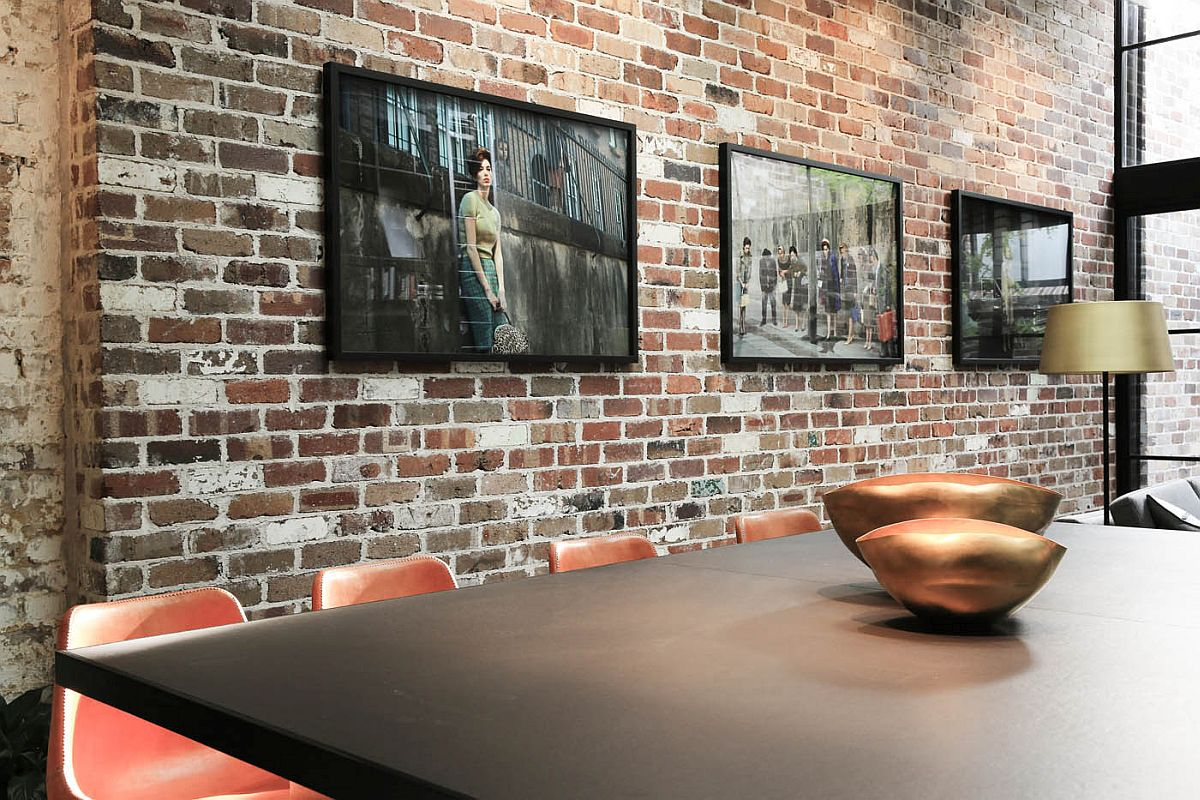 Curated wall art helps decorate the beautiful brick walls