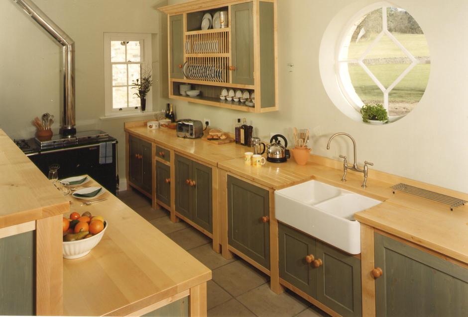 Cute round window in a wooden kitchen