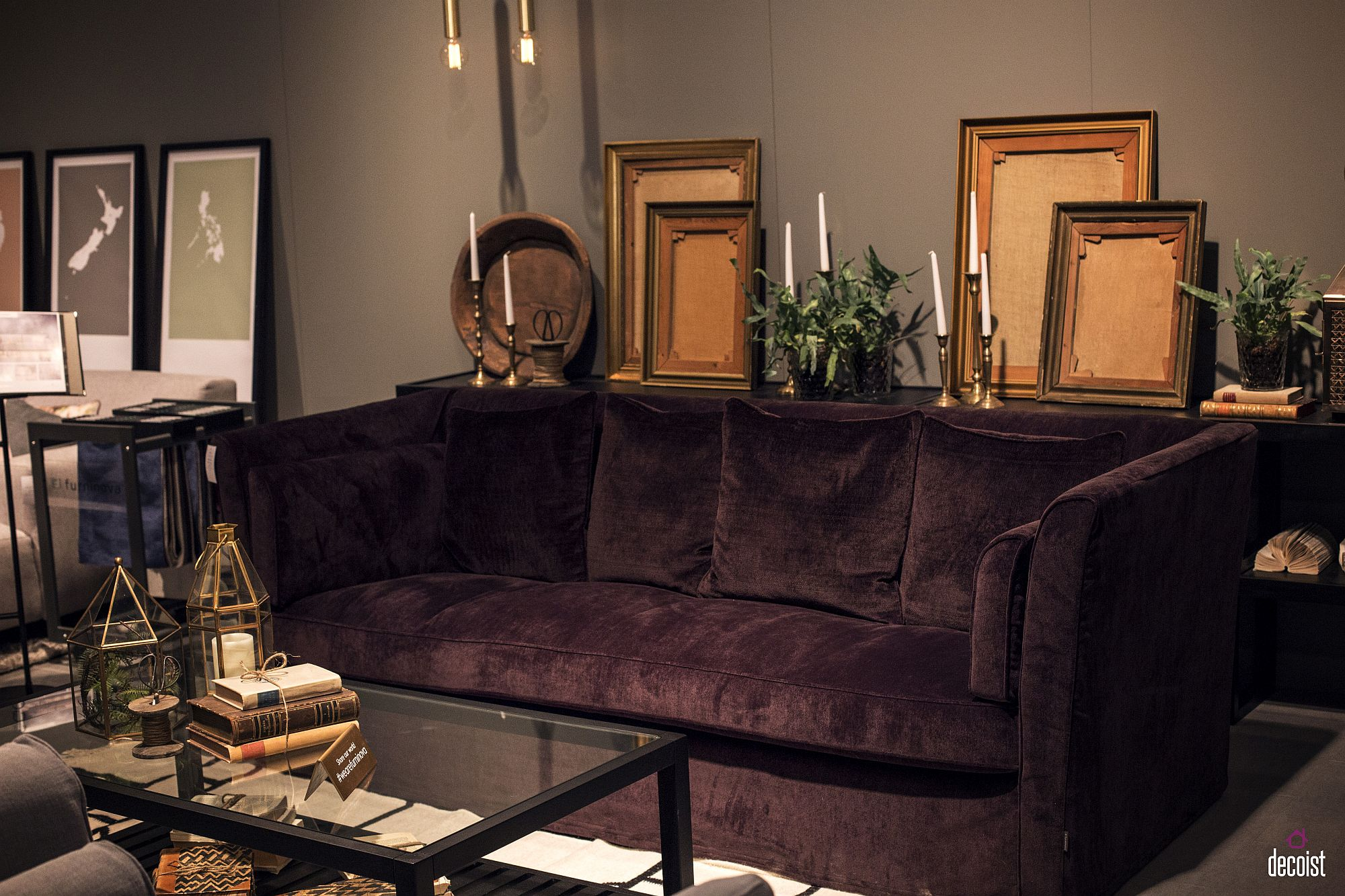 Dark colored sofa acnchors a living room in neutral hues with ease