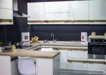 Dark-gray-anchors-the-breezy-kitchen-in-white-217x155