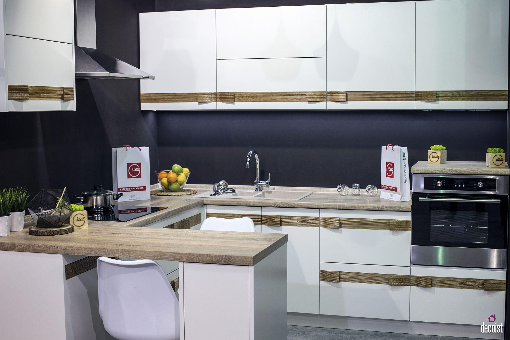 Dark gray anchors the breezy kitchen in white