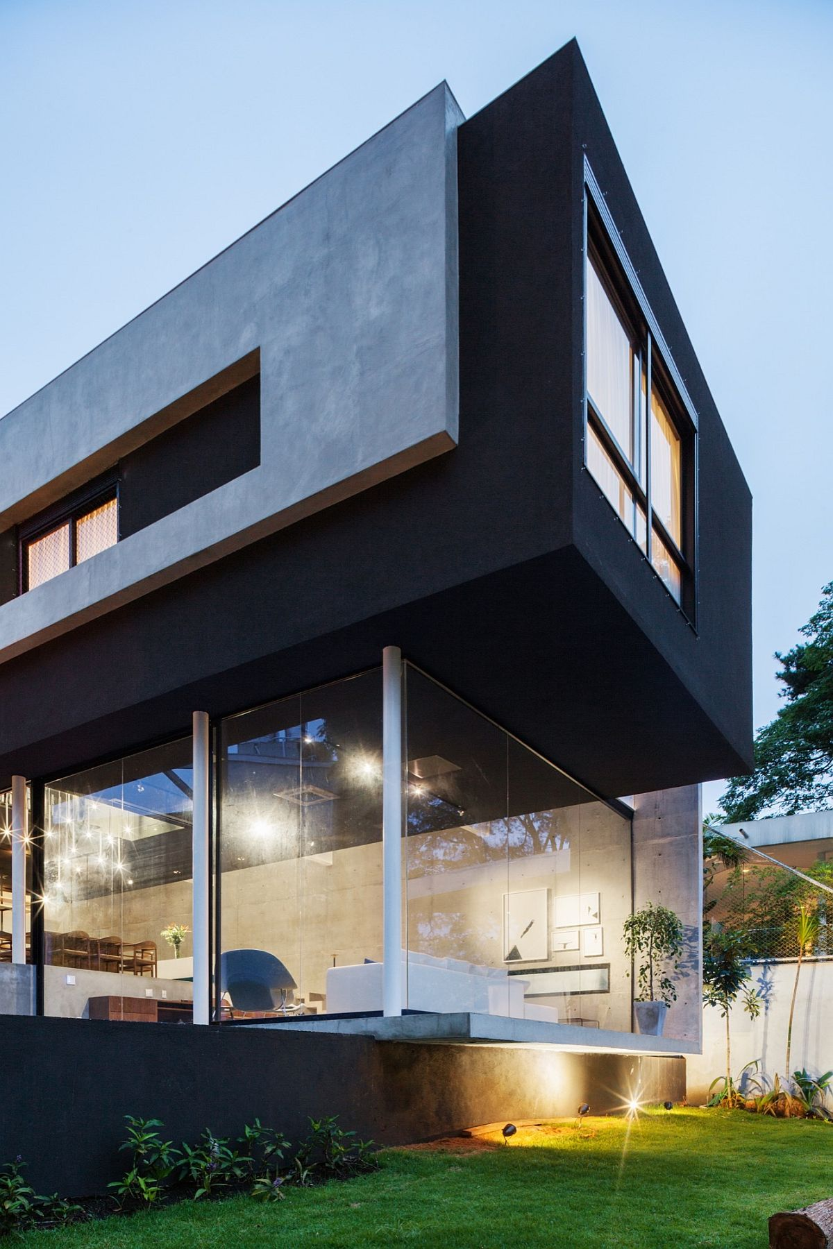 Dark-top-level-of-the-home-with-concrete-wall