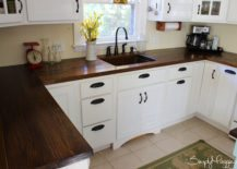 Dark-wooden-countertop-stands-out-in-a-small-kitchen-217x155